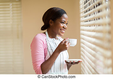 young african woman drinking coffee