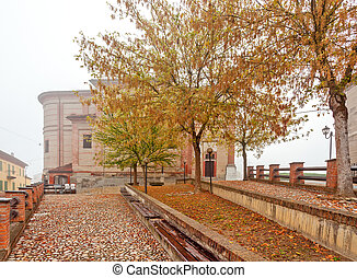 Street of Grinzane Cavour in autumn. - Cobbled street, trees...