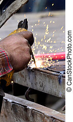 Dangerous welding without protective work wear - Picture of...