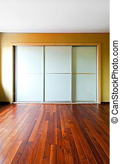 Glass closet 2 - Big closet with glass doors in empty room
