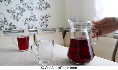 Woman pours into cup compote - Woman pours into the cup...