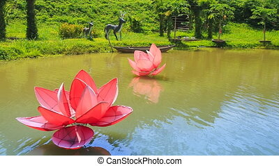 view of lake with artificial flowers in tropical tourist park