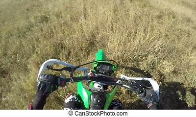 Point of View: Enduro racer on dirt bike riding off-road