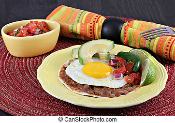 Tex Mex Huevos Rancheros, selective focus on egg - Tex Mex...