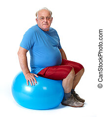 Elderly man sitting on exercise ball Sport and health