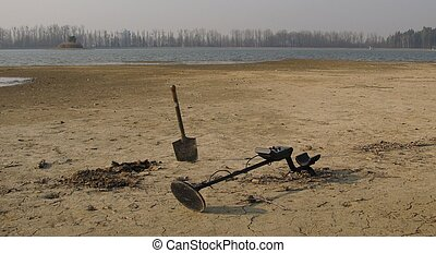 treasurehunting - metal detector with a shovel next to the...