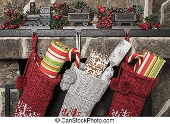 Christmas stockings - Stuffed stockings hanging on a...