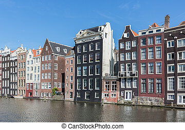 Amsterdam city with historic houses along Canals - Cityscape...