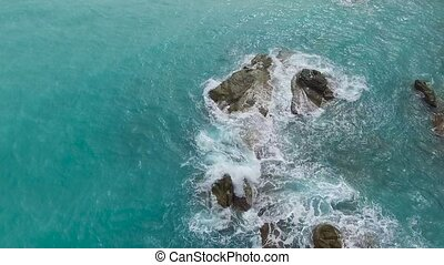 Aerial view on the sea waves