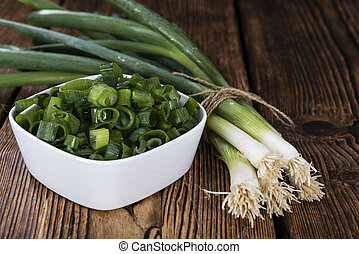 Portion of fresh Scallions (detailed close-up shot) on...