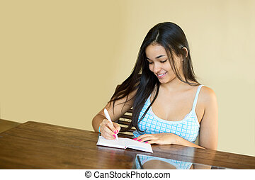 writing notes - young woman writing notes