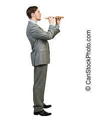 Businessman play fife - Cheerful businessman playing fife...