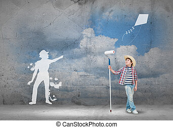 Happy childhood - Cute boy of school age painting wall with...