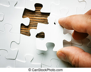 Hand with missing jigsaw puzzle piece. Business concept...