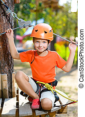 Young boy playing and having fun doing activities outdoors....