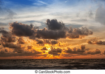 sunrise in the sea - beautiful sunrise with sky in the...