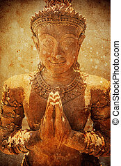 The Statue of Buddha made from stone on grunge background