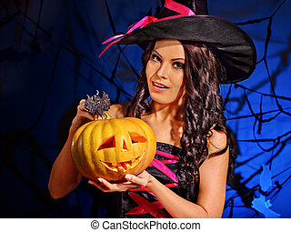 Witch holding pumpkin - Happy witch holding pumpkin lantern.