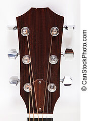 Guitar - Headstock of a classical guitar over white...
