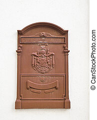 Postbox.  - This is a vintage brown postbox on the wall.