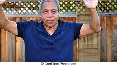 Hands up - African American man standing with his hands up