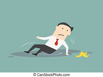 Businessman slipped on a banana peel and fell down in a...
