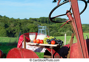 Milk at the farm - Milk and fruit at the farm on red tractor