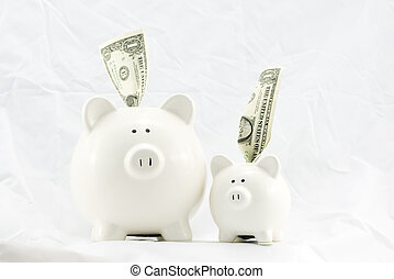 Family Piggy Banks - Two piggy banks inserted with american...