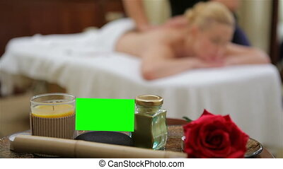 Picture of woman in spa salon lying on the massage desk....