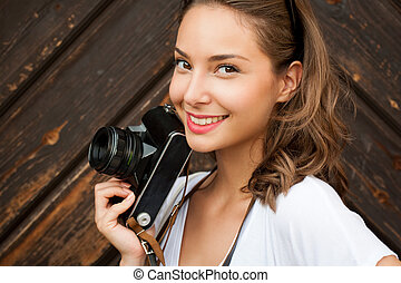 Young woman taking photos - Gorgeous young brunette woman...