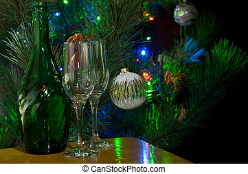 Christmas night - Two glasses and bottle of champagne in...