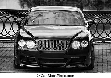 black luxury  car parked on the embankment