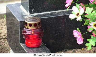 The lamp on the grave.