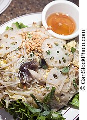 vietnamese food bun xao rice stir fried rice noodles with shredded vegetables egg crushed peanut vegetarian style mushrooms lotus root with nuoc cham sauce in bowl on side