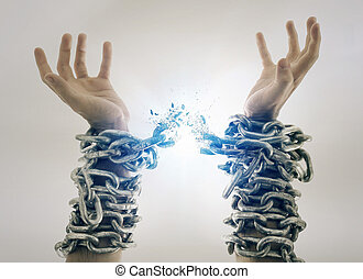 Broken chains - Two hands in chains that are breaking apart.