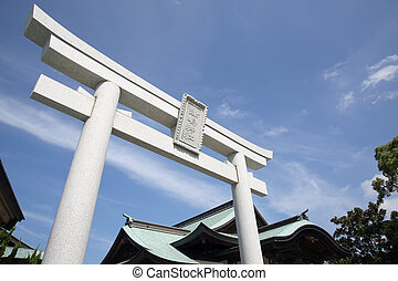 torii gate at shinto shrine in Japan