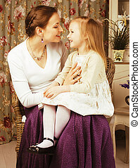 young mother with daughter at luxury home