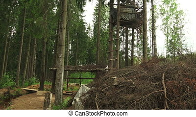 Military observation tower for in the forest. Shot in 4K...