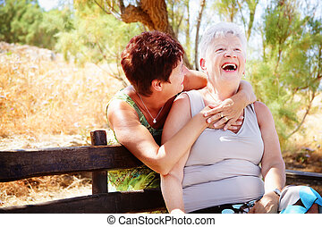 Beautiful senior mother and daughter having fun - Bright...