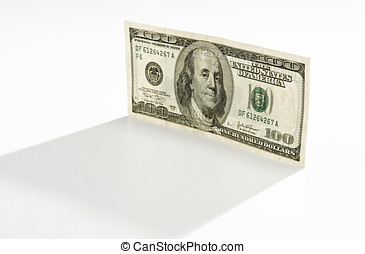 100 dollar bill standing on end, backlit on white...