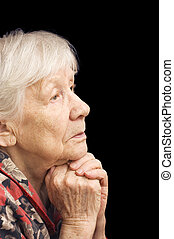The old woman prays on a black