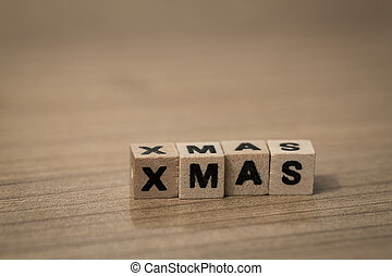 X-Mas in wooden cubes - X-Mas written in wooden cubes on a...