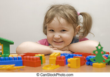 The beautiful girl with toy blocks