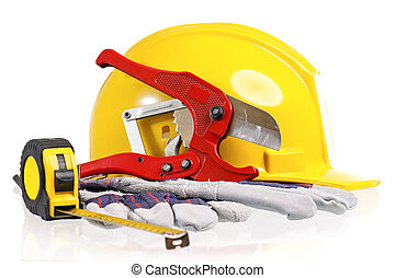 Hard hat - Yellow hard hat with work gloves and tools on a...