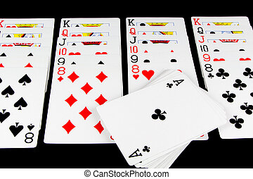 Playing Cards Game on Black Background - Playing cards being...