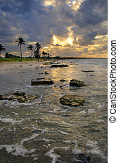 Beach scene with dramatic sunset, cuba - A view of cuban...