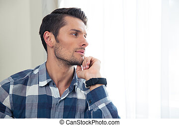 Casual man looking away - Portrait of a handsome casual man...