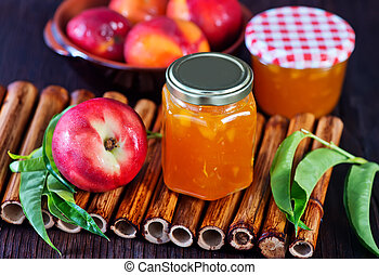 nectarine jam in bank and on a table