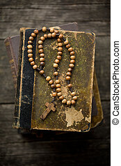 vintage rosary beads on old book - the vintage rosary beads...
