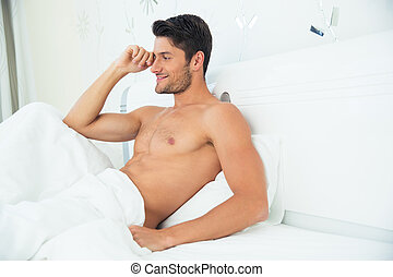 Man talking on the phone in bed